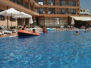 The swimming pool at or near Happy Aparthotel & Spa