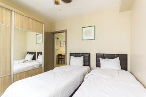 Кровать или кровати в номере Garan Apartments