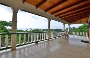 A balcony or terrace at Dragon Bay Villa