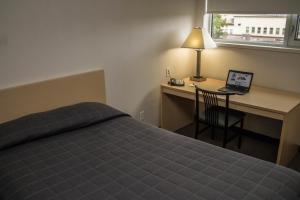 A bed or beds in a room at Residence & Conference Centre - Ottawa Downtown