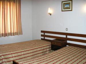 A bed or beds in a room at Apartamentos Vitoria