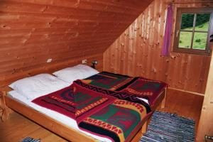 A bed or beds in a room at Bischofhütten