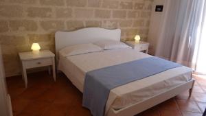 Letto o letti in una camera di Blu Vacanze Residence