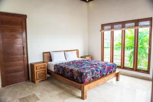A bed or beds in a room at Julia Villa