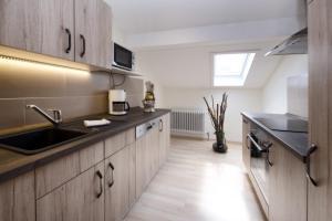 Küche/Küchenzeile in der Unterkunft Appartementhaus-Edelweiss