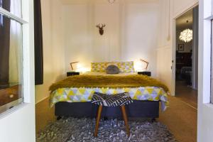 A bed or beds in a room at The Grey House