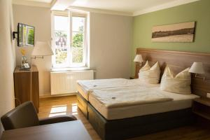 Ein Bett oder Betten in einem Zimmer der Unterkunft Bahnhofsquartier Bad Wilsnack