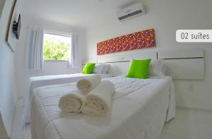 A bed or beds in a room at Residencial Mont Carmelo - Tonziro