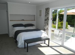 Posteľ alebo postele v izbe v ubytovaní Tasmangreen Studio