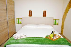 A bed or beds in a room at Appartamento San Giovanni