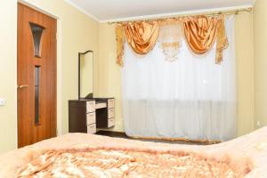 Кровать или кровати в номере Richhouse on Tolepova 7