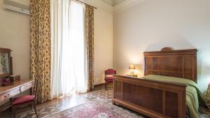 Letto o letti in una camera di Les Maisons Palazzo Beneventano