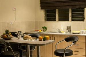 A kitchen or kitchenette at Victoria Apartments