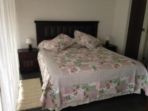 Cama o camas de una habitación en Santiago Rental Suites