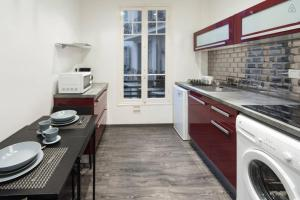 A kitchen or kitchenette at PAGANINI - New Lovely Cosy Flat in Heart of Nice