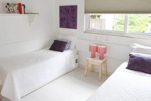 A bed or beds in a room at Leblon House I