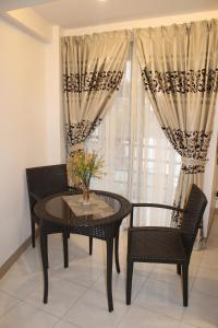 A seating area at Anahaw Studio Suites