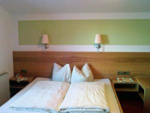 Ein Bett oder Betten in einem Zimmer der Unterkunft Apart Austria