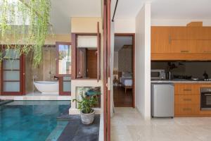 A kitchen or kitchenette at Beautiful Bali Villas by Nagisa Bali