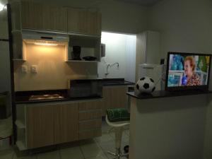A kitchen or kitchenette at Cumaru Flat Manaus 916