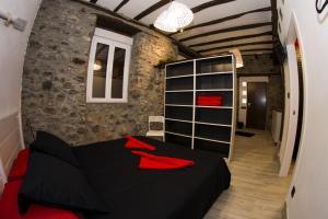 Cama o camas de una habitación en Andra Mari Apartamentu Turistikoak