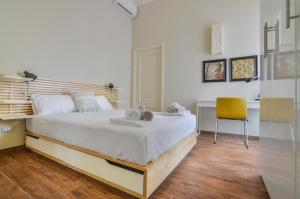 A bed or beds in a room at Corso di Porta Romana Halldis Apartments