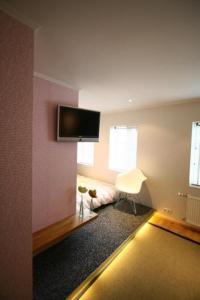 Ein Bett oder Betten in einem Zimmer der Unterkunft Home Luxury Apartments