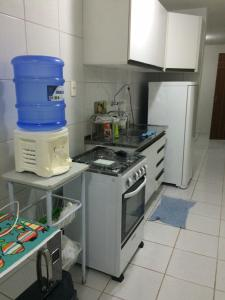 A kitchen or kitchenette at Residencial Horizonte Tropical