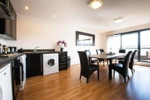 A kitchen or kitchenette at Westport Serviced Apartments
