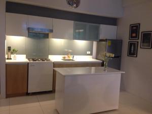 A kitchen or kitchenette at Condominium at Carola