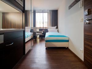Кровать или кровати в номере Boardinghouse Bielefeld