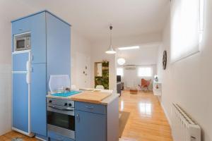 Una cocina o zona de cocina en Apartamentos Las Letras