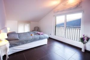 Ein Bett oder Betten in einem Zimmer der Unterkunft Colonno Apartment