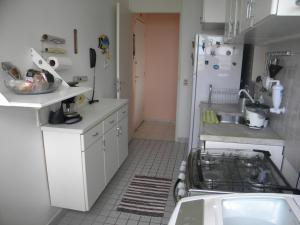 A kitchen or kitchenette at Apartamento Chile