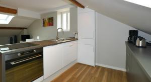 A kitchen or kitchenette at Appart' Jarente