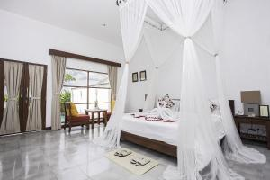 A bed or beds in a room at Alam Puisi Villa