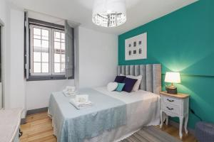 A bed or beds in a room at LxWay Apartments Elevador da Bica