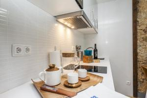 A kitchen or kitchenette at LxWay Apartments Elevador da Bica