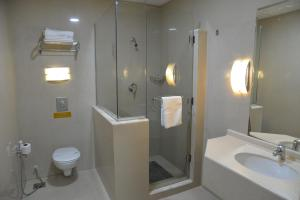 A bathroom at The Palace Suites