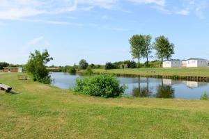 A garden outside Storkesøen Ribe Holiday Cottages and Apartments
