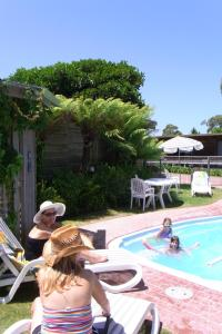 The swimming pool at or near Lazy Acre Log Cabins