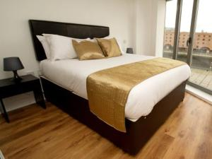 A bed or beds in a room at The Block Liverpool