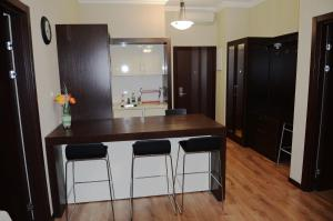 A kitchen or kitchenette at Горки Город Апартаменты