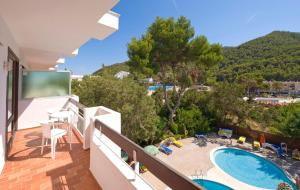 A view of the pool at Apartamentos Cala LLonga Playa or nearby