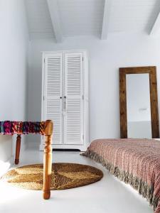 Cama o camas de una habitación en Akassa Alojamientos Bioclimaticos en las Hurdes
