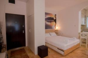 A bed or beds in a room at Apartment Dositej 3