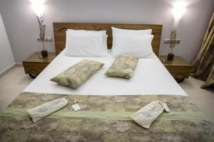 A bed or beds in a room at Ionion Beach Apartment Hotel & Spa
