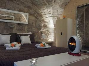 A bed or beds in a room at Atmosfere Di Roccia