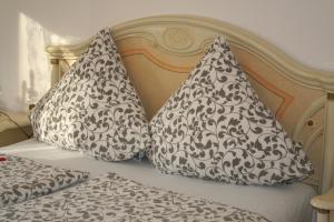 Ein Bett oder Betten in einem Zimmer der Unterkunft Herz der Weinberge