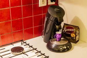 A kitchen or kitchenette at Appartement du Bonheur